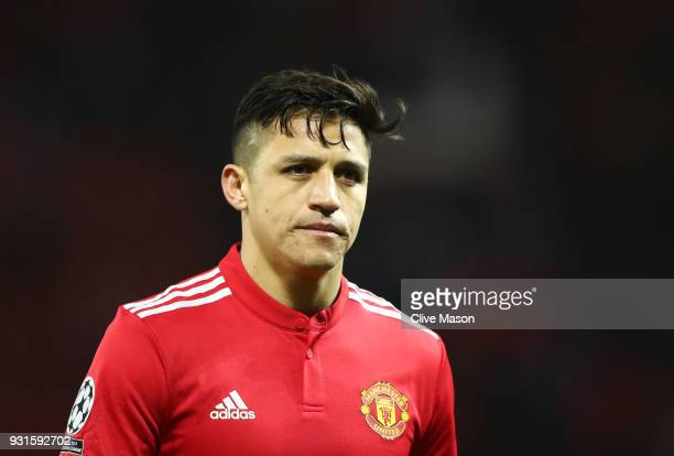Alexis Sanchez of Manchester United looks dejected in defeat after the UEFA Champions League Round of 16 Second Leg match between Manchester United...