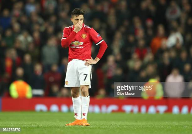 Alexis Sanchez of Manchester United looks despondent during the UEFA Champions League Round of 16 Second Leg match between Manchester United and...