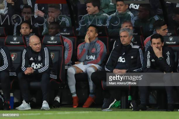Alexis Sanchez of Manchester United looks on behind Jose Mourinho from the subs bench during the Premier League match between AFC Bournemouth and...