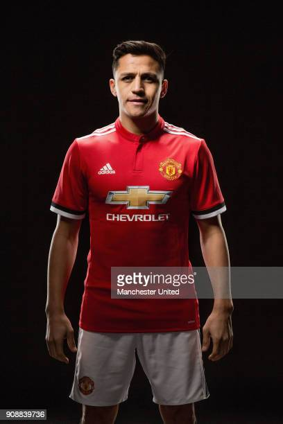 Alexis Sanchez of Manchester United poses after signing for the club at Old Trafford on January 22 2018 in Manchester England