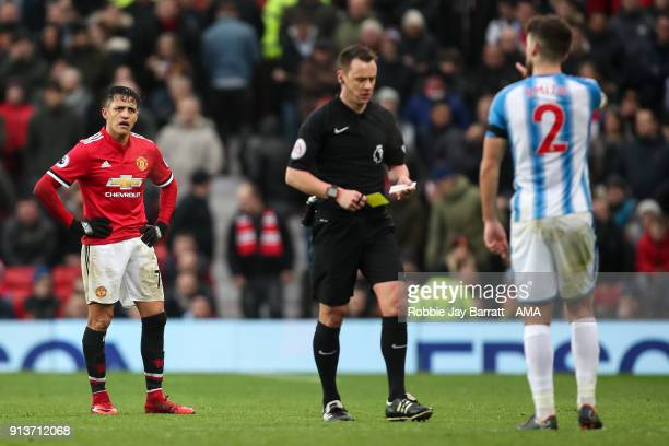 Alexis Sanchez of Manchester United reacts after receiving a yellow card during the Premier League match between Manchester United and Huddersfield...