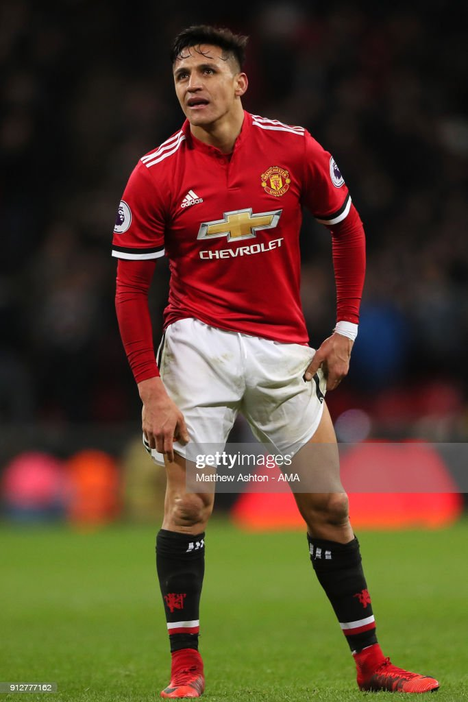 Alexis Sanchez of Manchester United reacts during the Premier League match between Tottenham Hotspur and Manchester United at Wembley Stadium on January 31, 2018 in London, England.
