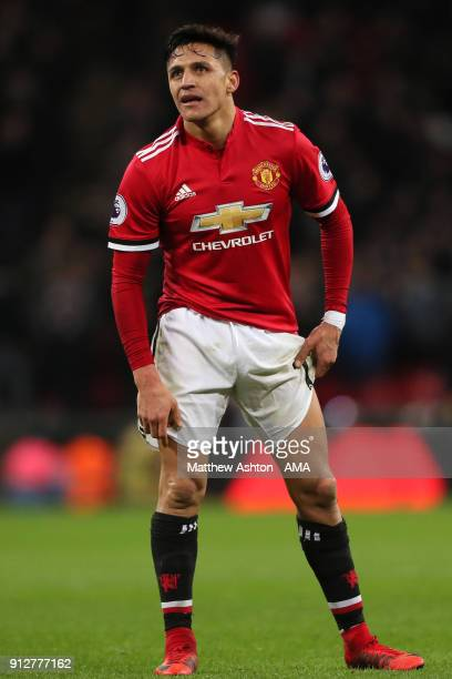 Alexis Sanchez of Manchester United reacts during the Premier League match between Tottenham Hotspur and Manchester United at Wembley Stadium on...