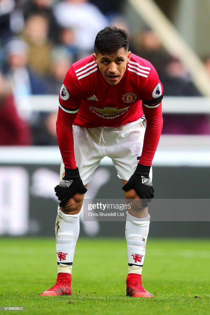 Alexis Sanchez of Manchester United reacts during the Premier League match between Newcastle United and Manchester United at St. James Park on February 11, 2018 in Newcastle upon Tyne, England.