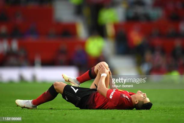 Alexis Sanchez of Manchester United reacts with an injury during the Premier League match between Manchester United and Southampton FC at Old...