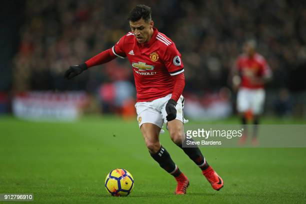 Alexis Sanchez of Manchester United runs with the ball during the Premier League match between Tottenham Hotspur and Manchester United at Wembley...
