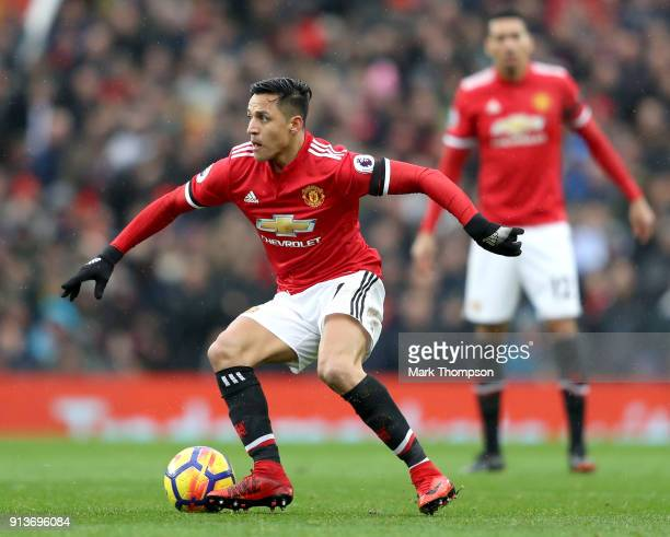 Alexis Sanchez of Manchester United runs with the ball during the Premier League match between Manchester United and Huddersfield Town at Old...