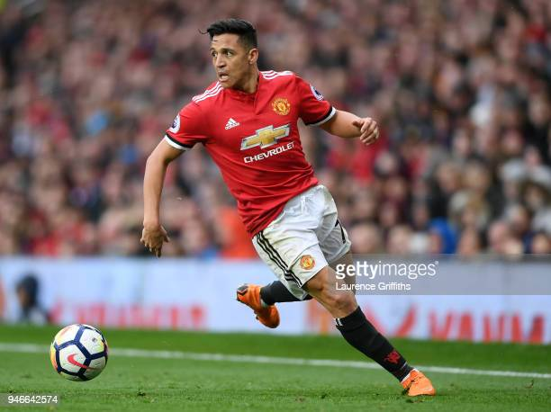 Alexis Sanchez of Manchester United runs with the ball during the Premier League match between Manchester United and West Bromwich Albion at Old...