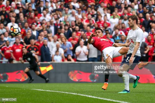 Alexis Sanchez of Manchester United scores a goal to make it 11 during The Emirates FA Cup Semi Final match between Manchester United and Tottenham...