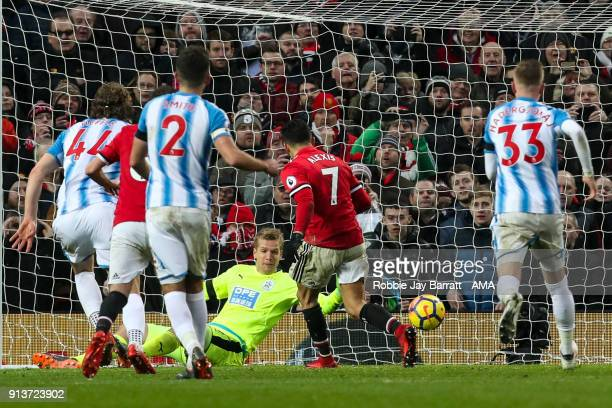 Alexis Sanchez of Manchester United scores a goal to make it 20 during the Premier League match between Manchester United and Huddersfield Town at...