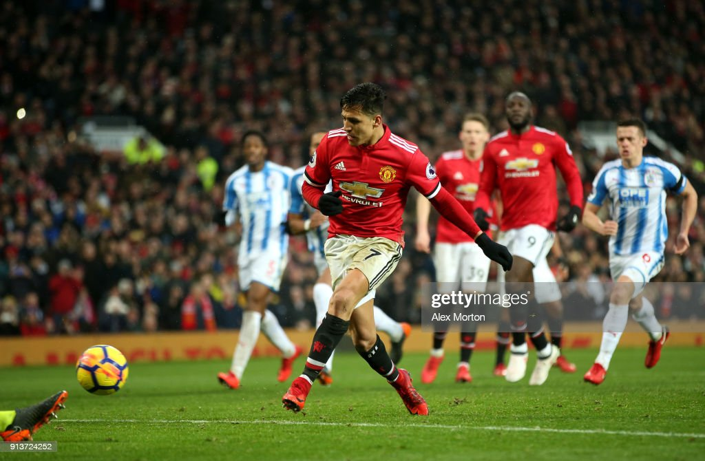 Alexis Sanchez of Manchester United scores his sides second goal during the Premier League match between Manchester United and Huddersfield Town at Old Trafford on February 3, 2018 in Manchester, England.