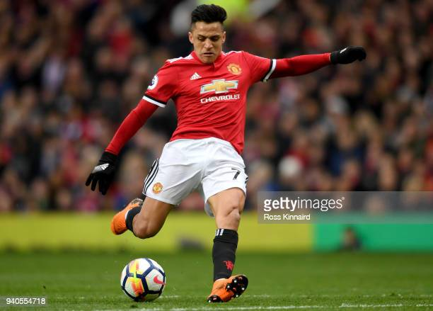 Alexis Sanchez of Manchester United scores his sides second goal during the Premier League match between Manchester United and Swansea City at Old...