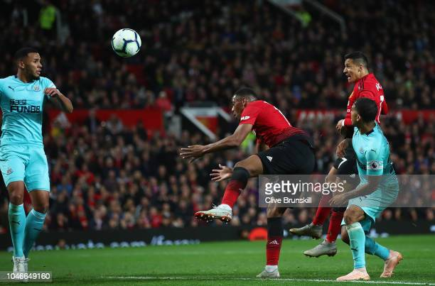 Alexis Sanchez of Manchester United scores his teams third and winning goal during the Premier League match between Manchester United and Newcastle...