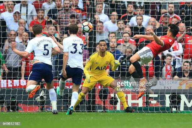 Alexis Sanchez of Manchester United scores the equalising goal during The Emirates FA Cup Semi Final at Wembley Stadium between Manchester United and...