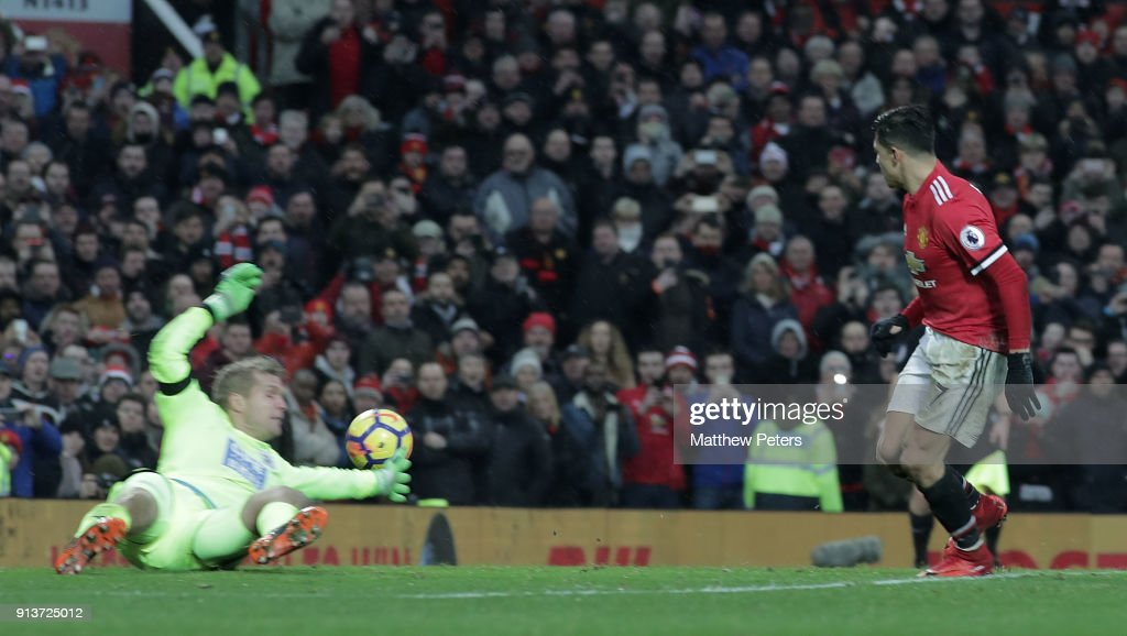 Alexis Sanchez of Manchester United scores their second goal during the Premier League match between Manchester United and Huddersfield Town at Old Trafford on February 3, 2018 in Manchester, England.