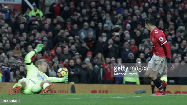 Alexis Sanchez of Manchester United scores their second goal during the Premier League match between Manchester United and Huddersfield Town at Old...