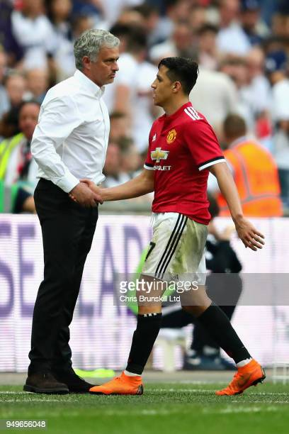 Alexis Sanchez of Manchester United shakes hands with his manager Jose Mourinho as he is substituted during The Emirates FA Cup Semi Final match...