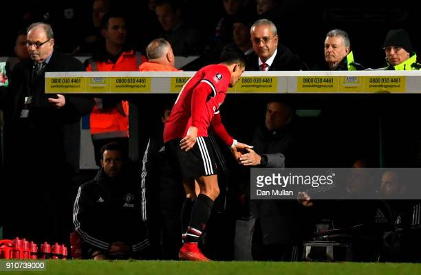 Alexis Sanchez of Manchester United shakes hands with Jose Mourinho Manager of Manchester United as he is substituted during The Emirates FA Cup...