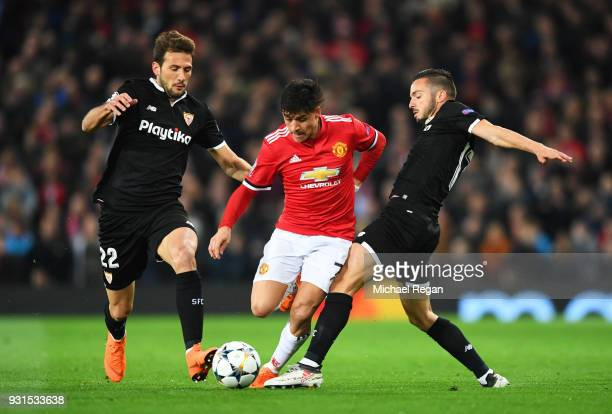 Alexis Sanchez of Manchester United takes on Franco Vazquez and Pablo Sarabia of Sevilla during the UEFA Champions League Round of 16 Second Leg...