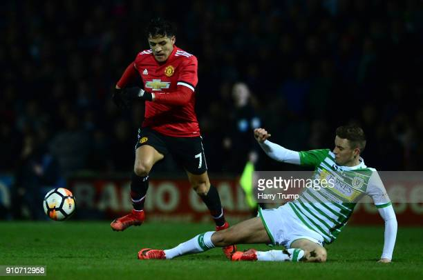 Alexis Sanchez of Manchester United takes on Lewis Wing of Yeovil Town during The Emirates FA Cup Fourth Round match between Yeovil Town and...