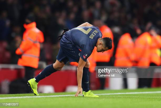 Alexis Sanchez of Manchester United touches the turf as he walks onto the pitch prior to the FA Cup Fourth Round match between Arsenal and Manchester...