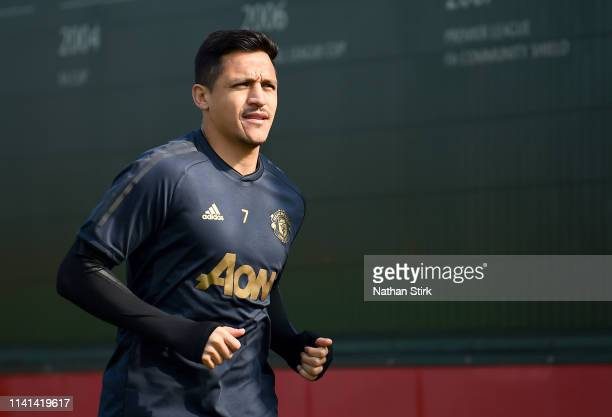 Alexis Sanchez of Manchester United walks off after the Manchester United training session ahead of the UEFA Champions League Quarter Final First Leg...