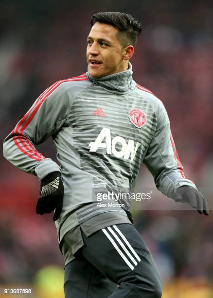 Alexis Sanchez of Manchester United warms up prior to the Premier League match between Manchester United and Huddersfield Town at Old Trafford on...