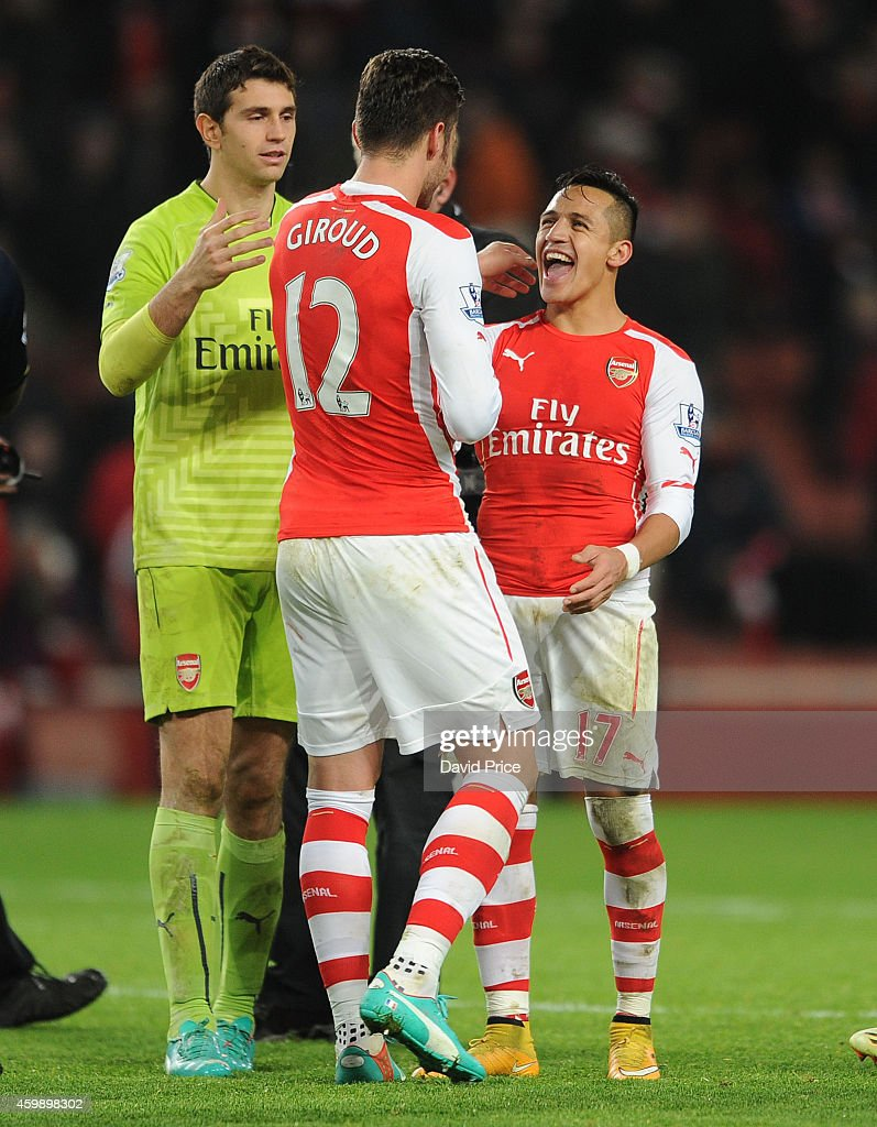 Alexis Sanchez, Olivier Giroud and Emiliano Martinez of Arsenal after the match between Arsenal and Southampton in the Barclays Premier League at Emirates Stadium on December 3, 2014 in London, England.