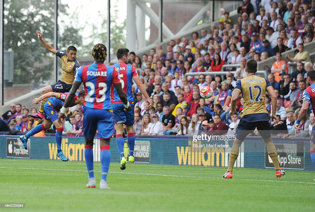 Alexis Sanchez outjumps the Crystal Palace defence to score the 2nd Arsenal goal during the Barclays Premier League match between Crystal Palace and Arsenal at Selhurst Park on August 16, 2015 in London, United Kingdom.