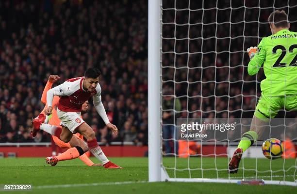 Alexis Sanchez scores Arsenal's 1st goal during the Premier League match between Arsenal and Liverpool at Emirates Stadium on December 22 2017 in...