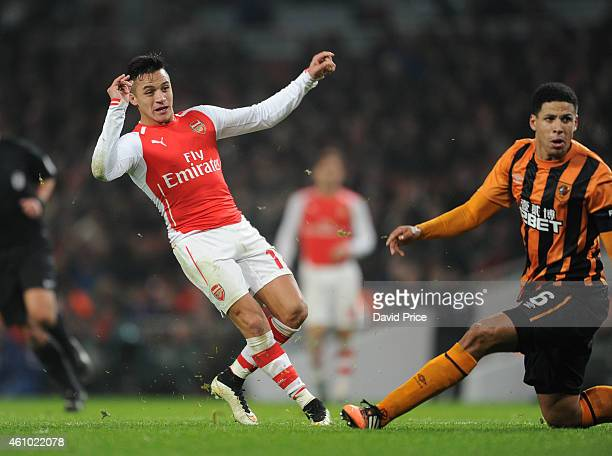 Alexis Sanchez scores Arsenal's 2nd goal as Curtis Davies of Hull looks on during the match between Arsenal and Hull City in the FA Cup 3rd Round at...