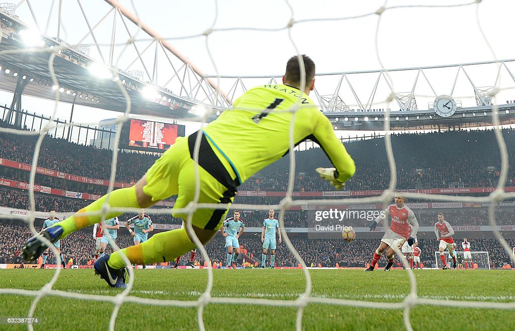Alexis Sanchez scores Arsenal's 2nd goal from the penalty spot past Tom Heaton of Burnley during the Premier League match between Arsenal and Burnley at Emirates Stadium on January 22, 2017 in London, England.