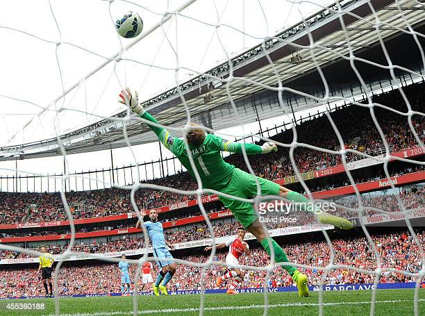 Alexis Sanchez scores Arsenal's 2nd goal past Joe Hart of Manchester City during the Barclays Premier League match between Arsenal and Manchester...