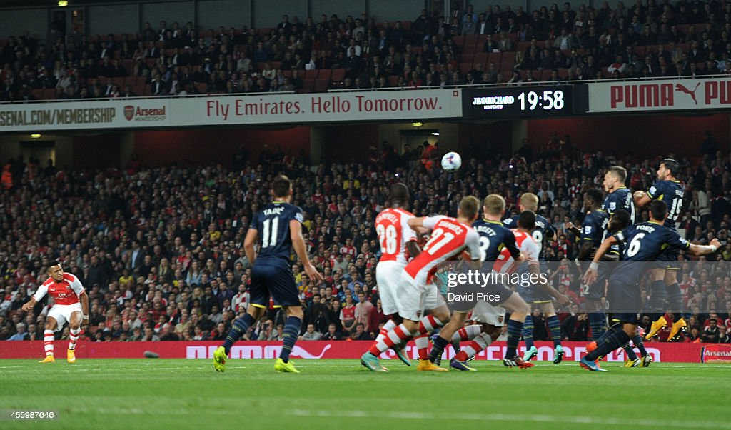 Alexis Sanchez scores Arsenal's goal from a free kick during the Capital One Cup 3rd match between Arsenal and Southampton at Emirates Stadium on September 23, 2014 in London, England.