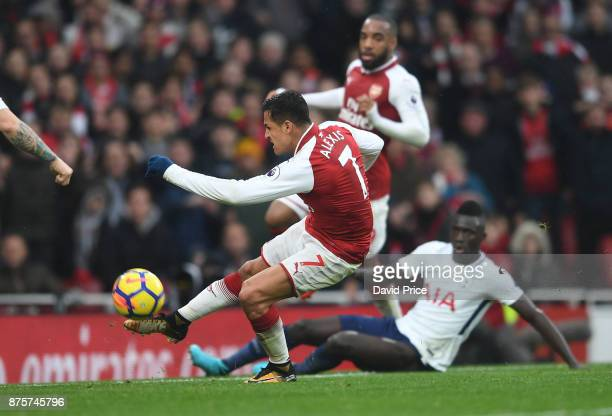 Alexis Sanchez scores Arsenal's second goal during the Premier League match between Arsenal and Tottenham Hotspur at Emirates Stadium on November 18...