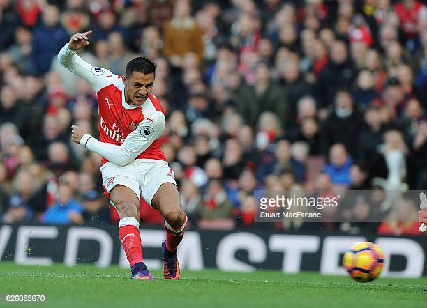 Alexis Sanchez scores for Arsenal during the Premier League match between Arsenal and AFC Bournemouth at Emirates Stadium on November 27 2016 in...