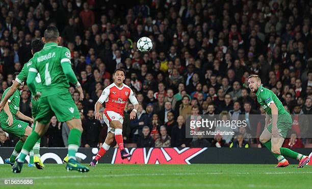 Alexis Sanchez scores for Arsneal the UEFA Champions League match between Arsenal FC and PFC Ludogorets Razgrad at Emirates Stadium on October 19...