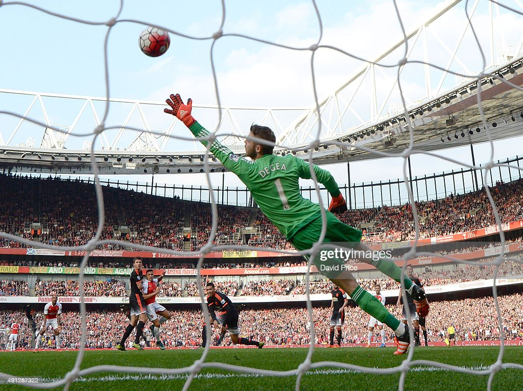 Alexis Sanchez scores his 2nd goal, Arsenal's 3rd, past David De Gea of manchester United during the Barclays Premier League match between Arsenal and Manchester United at at Emirates Stadium on October 4, 2015 in London, England.