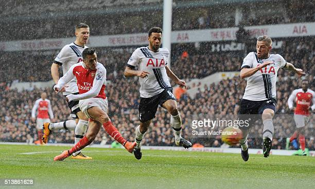 Alexis Sanchez shoots past Tottenham's Mousa Dembele and Kevin Wimmer during the Barclays Premier League match between Tottenham Hotspur and Arsenal...
