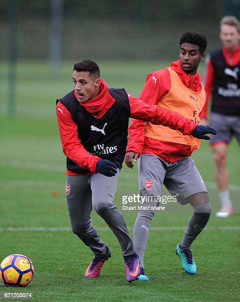 Alexis Sanxhez and Gedion Zelalem of Arsenal during a training session at London Colney on November 5 2016 in St Albans England