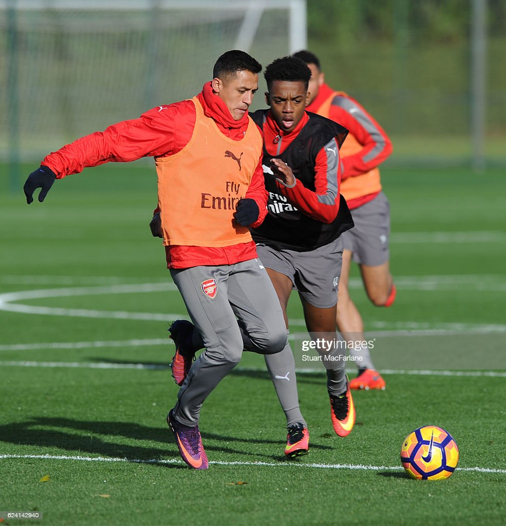 Alexis Sanxhez and Joe Willock of Arsenal during a training session at London Colney on November 18, 2016 in St Albans, England.
