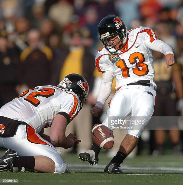 Alexis Serna of Oregon State kicks a PAT as holder Jon Stowbridge looks on during the 2006 Brut Sun Bowl against Missouri at Sun Bowl Stadium in El...