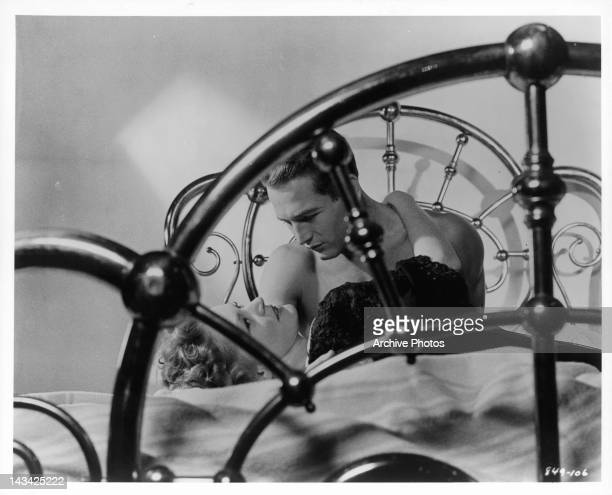 Alexis Smith and Paul Newman in bed in a scene from the film 'The Young Philadelphians' 1959