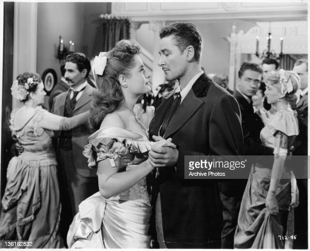 Alexis Smith dancing with Errol Flynn in a scene from the film 'Montana' 1950