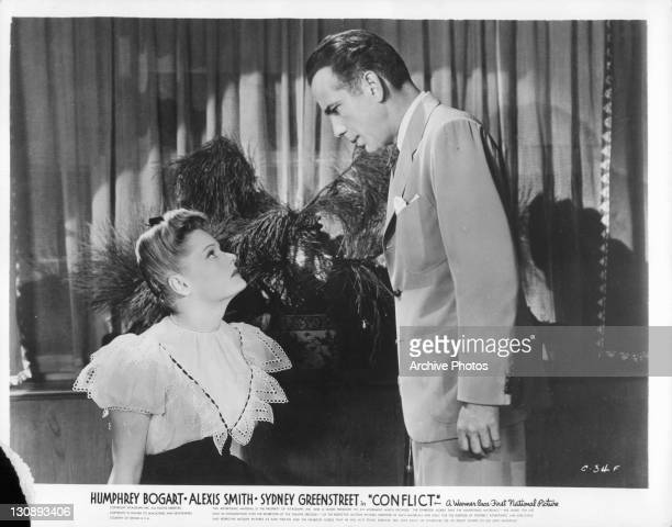 Alexis Smith looking up at Humphrey Bogart in a scene from the film 'Conflict' 1945