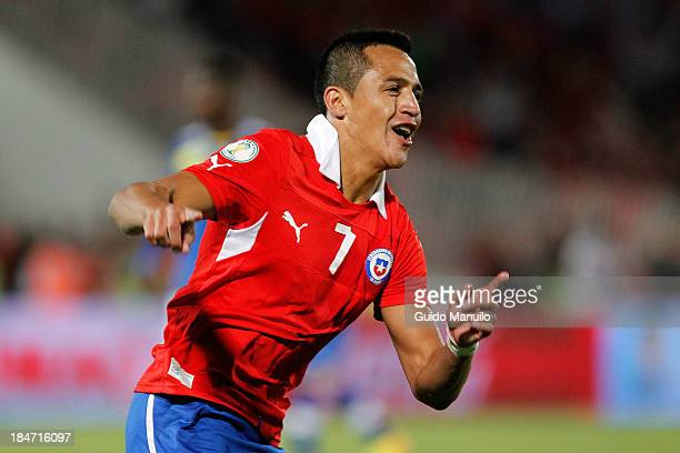 Alexis Sánchez of Chile celebrates a scored goal against Ecuador during a match between Chile and Ecuador as part of the 18th round of the South...