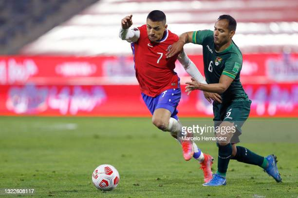 Alexis Sánchez of Chile competes for the ball with Leonel Justiniano of Bolivia during a match between Chile and Bolivia as part of South American...