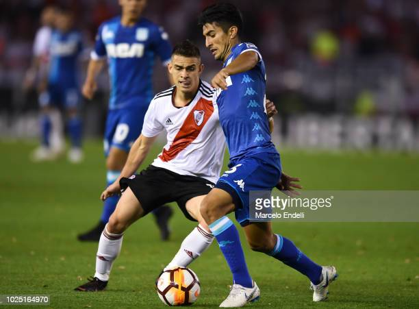 Alexis Soto of Racing Club fights for the ball with Rafael Santos Borre of River Plate during a round of sixteen second leg match between River Plate...