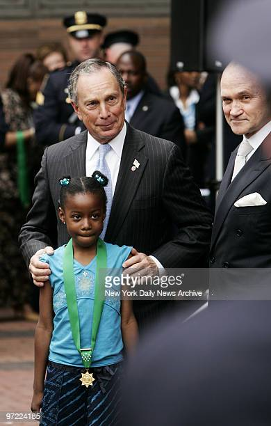Alexis Stewart wears a Medal of Honor as she stands with Mayor Michael Bloomberg and Police Commissioner Ray Kelly during an NYPD Medal Day Ceremony...