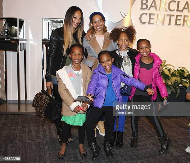 Alexis Stoudemire and Amber Sabathia pose with their kids Assata Stoudemire Cyia Sabathia Ar'e Stoudemire and Jayden Sabathia at Disney On Ice...